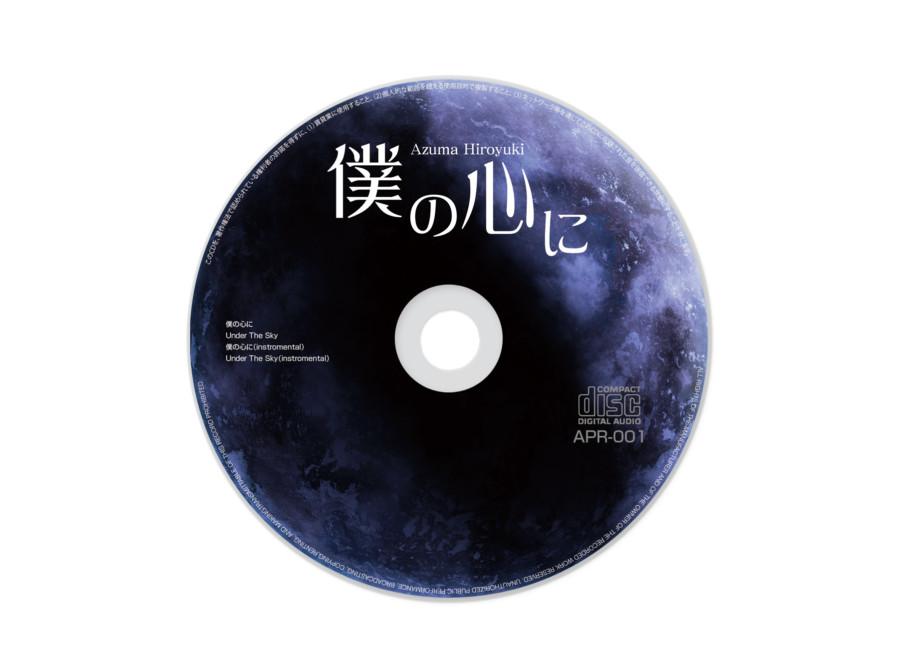 盤面に月を描いたシンガーのCD盤面デザイン